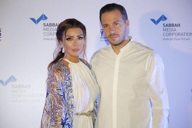 الممثلة أمل بوشوشة وزوجها