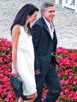 أمل علم الدين الف وزوجها جورج كلوني فرحان بالتوأمين خلال بداية الحمل في إيطاليا