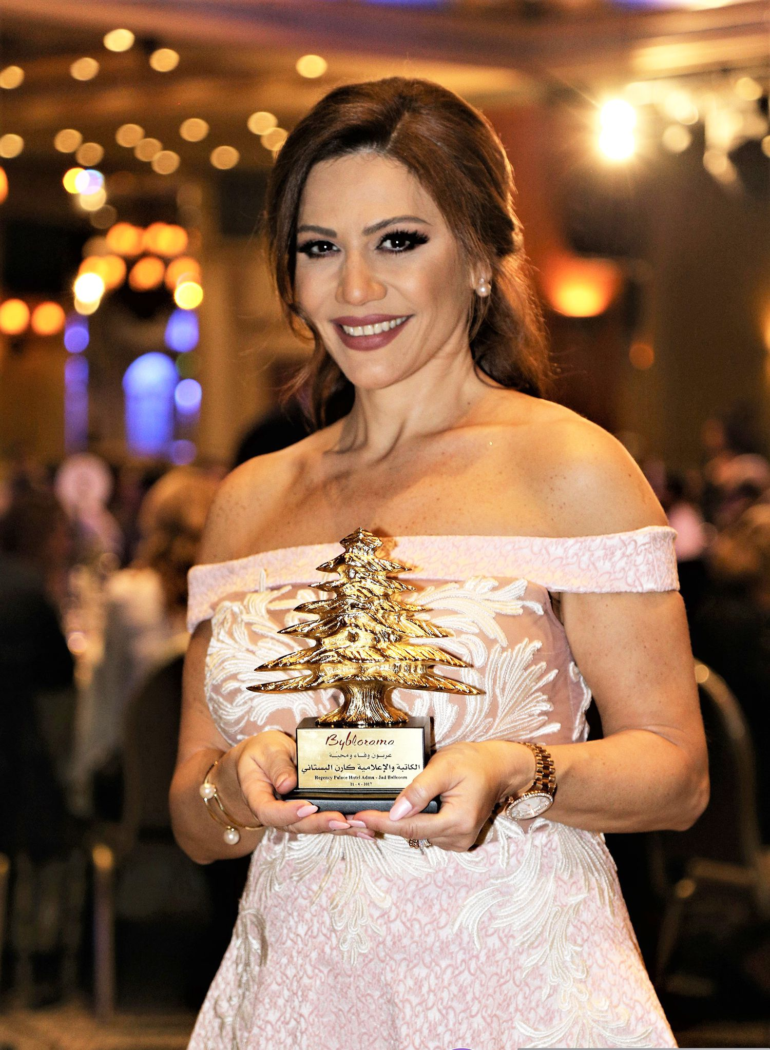 Karen Boustany poses with her award