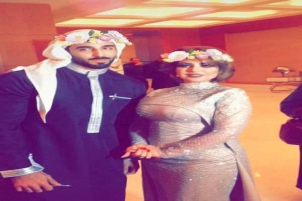 الاعلامية الكويتية حليمة بولند مع عارض الازياء السعودي