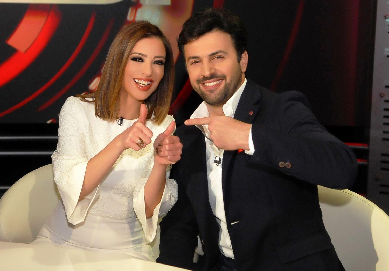 النجم السوري تيم حسن وزوجته الإعلامية المصرية وفاء الكيلاني