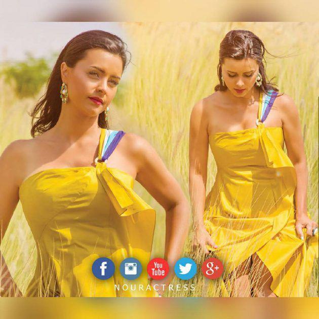 النجمة اللبنانية نور بفستان أصفر أنيق