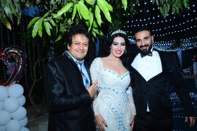 العروسان سمية الخشاب وأحمد سعد برفقة المصور سيد شعراوي