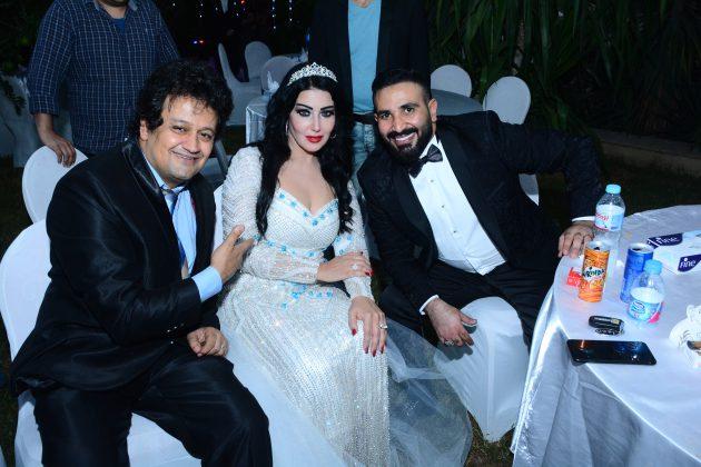 سمية الخشاب وأحمد سعد برفقة المصور سيد شعراوي