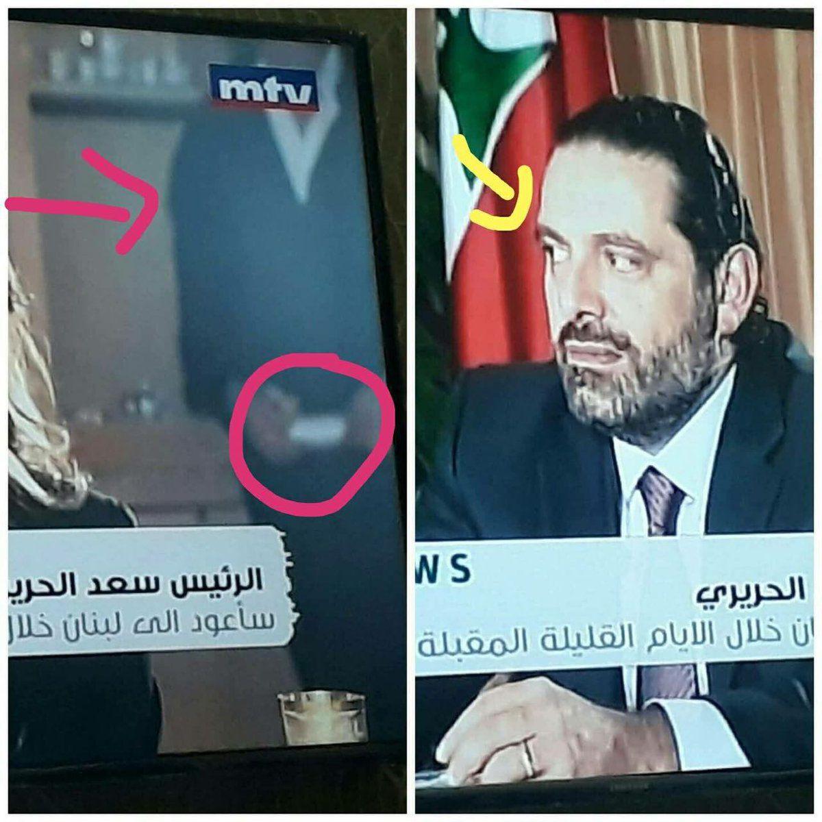نظرات سعد الحريري والشخص بالزي الرسمي
