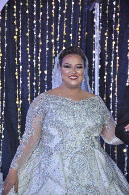 دينا محسن تبهر الفتيات بفستان زفافها