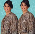 نوال الكويتية مع زوجها على الشاطيء - صورة
