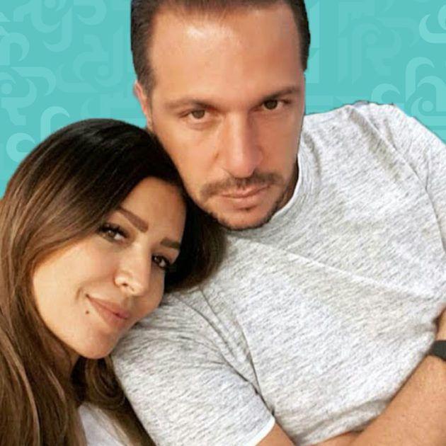 أمل بوشوشة مع زوجها على السرير - صورة