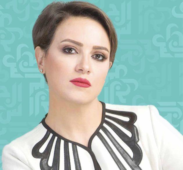 ريهام عبد الغفور تحضن طفل متلازمة داون - صور