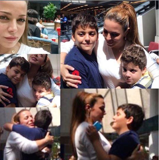 سوزان نجم الدين مع طفليْها
