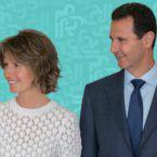 بشار وأسماء الأسد يهتمان بطفل في قصرهما - صورة