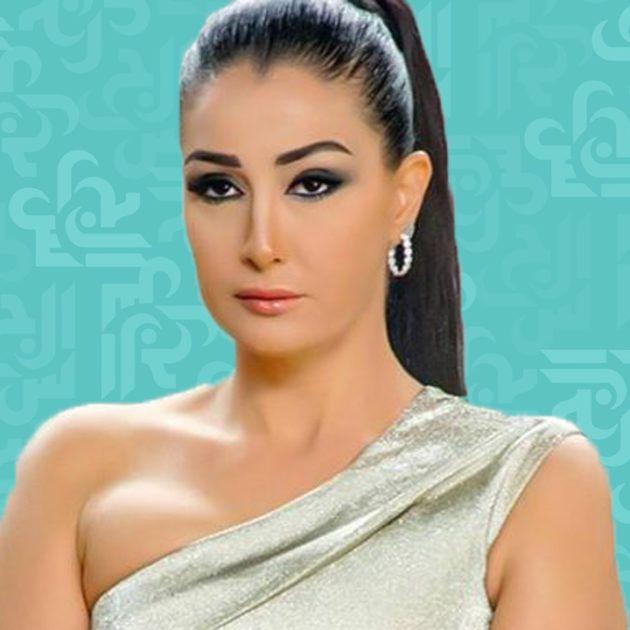 غادة عبد الرازق تحضن زوجها ولا تهتم - صورة